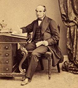 John Couch Adams(1819-1892)sitting at a Davenport desk